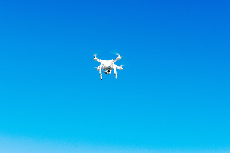 Uav drone copter flying with digital camera. Hexacopter drone with high resolution digital camera on the sky. Stock Photo