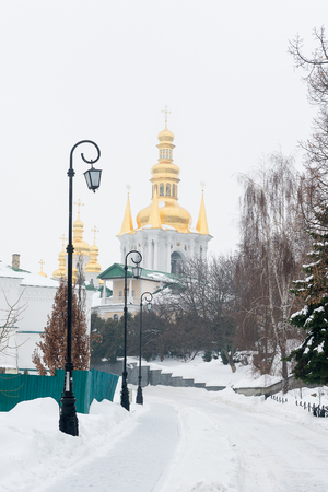 Kiev, Ukraine. Pechersk Lavra Monastery. A snow-covered avenue leading to distant caves.