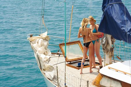Two young girls are sailing on a yacht Stock Photo - 591396