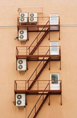 External air-conditioner units mounted outside on a wall Stock Photo