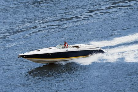 Speedboat cruising in the river. Fast drive photo