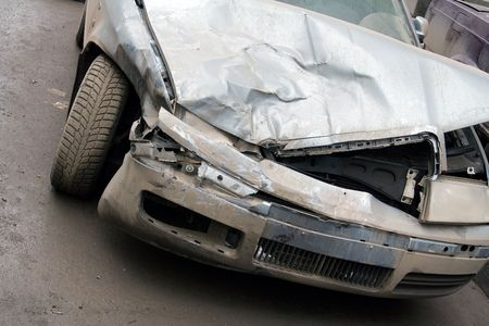 crashed: The Wrecked Car. Front of damaged auto. Stock Photo