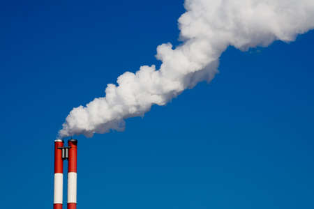 industrie: The chimney of a factory with white smoke