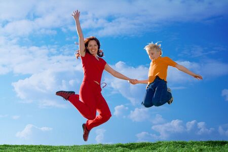 Flying  Family. Mother and Son Jumping Stock Photo - 906051