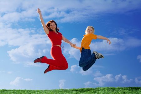 Flying  Family. Mother and Son Jumping photo