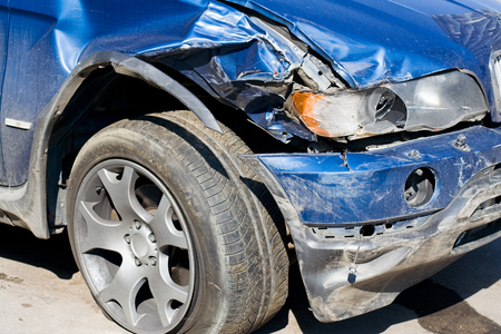 hassle: The Wrecked Car. Front of damaged auto. Stock Photo