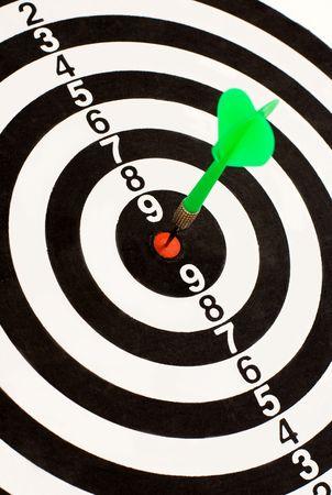 Green dart stuck in the center