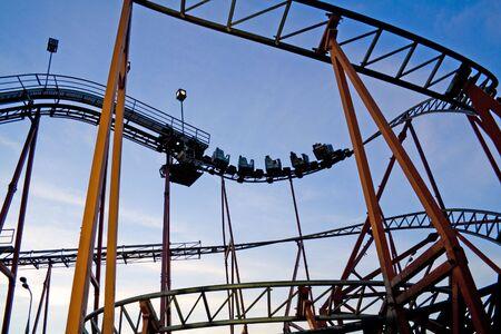 Roller coaster at an amusement park. Evening