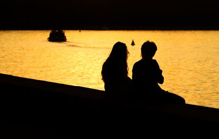 Silhouette of Young Couple at Sunset photo