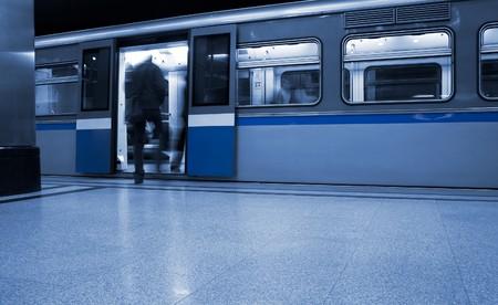 Subway. Underground station, motion blur. Tint blue photo