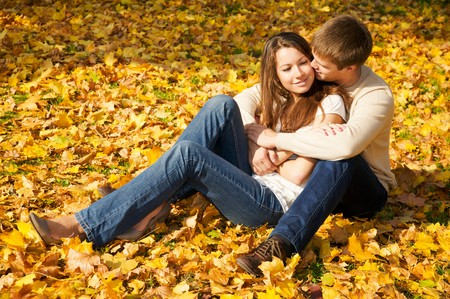 fall fun: Happy young couple in love meeting in the autumn park