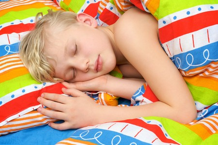 Sleeping cute child on the bed Stock Photo - 4285085