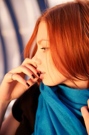 Close-up portrait of a sexy young woman with beautiful red hair photo