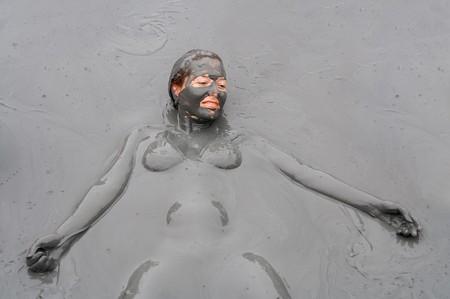 mud girl: Mud treatment Stock Photo