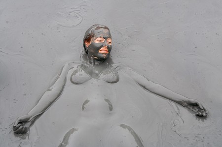 mud woman: Mud treatment Stock Photo