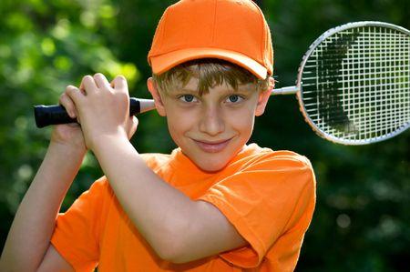 Cute boy with badminton racket photo