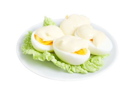 dietology: Eggs with mayonnaise on green lettuce leaf Stock Photo