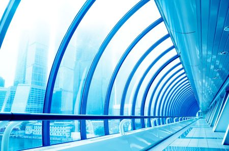 Glass corridor in modern business centre. Tint Blue photo