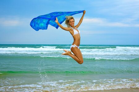 Beautiful happy woman enjoys freedom on tropical beach Stock Photo - 5675514
