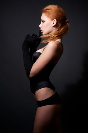 Attractive redhead model posing on studio dark background Stock Photo - 6368112