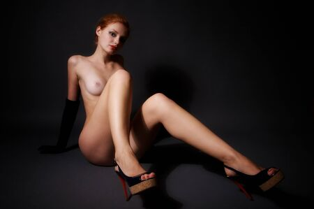 Young beautiful nude woman sitting on the floor Stock Photo
