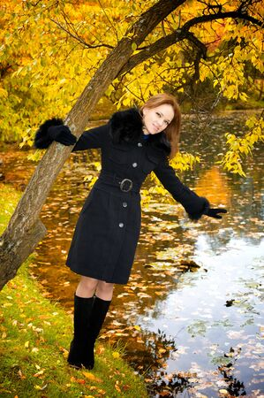 Young beautiful woman in a black coat in the autumn park Stock Photo - 6929006