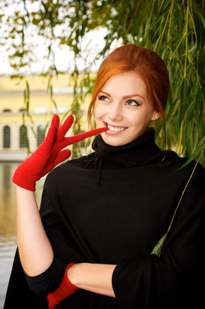 Portrait of a beautiful red-haired woman in red gloves Zdjęcie Seryjne - 6928994