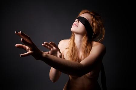Beautiful naked woman with bandage