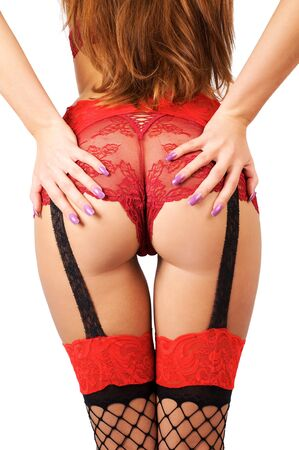 Buttocks of young beautiful woman in red sexy panties and stockings over white background Stock Photo - 6942253