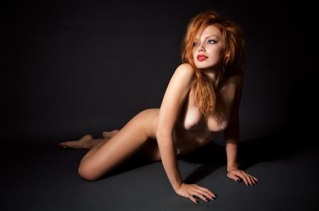 Fashion portrait of nude elegant woman on the floor
