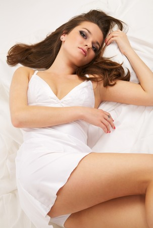 Beautiful young woman lying in bed Stock Photo - 7009399