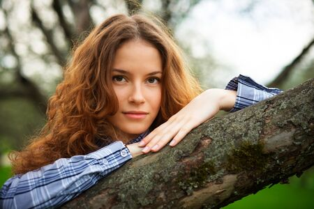 portrait of a beautiful redhead girl in the spring garden Stock Photo - 7009401