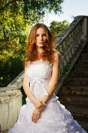 Bride posing on stairs of old abandoned house Stock Photo - 7274726