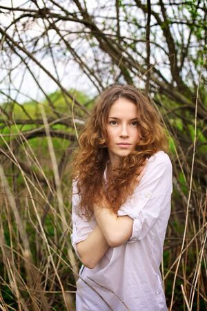 Portrait of a beautiful redhead girl in the spring garden Stock Photo - 7274725