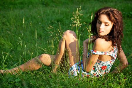 Young sexy woman posing outdoors photo