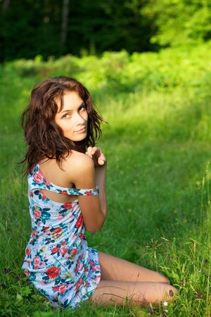 Young sexy woman posing outdoors Stock Photo