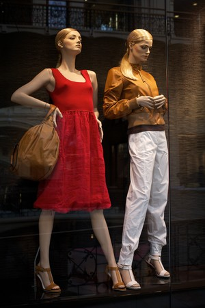 boutique shop: Mannequins in clothes shop. No brandnames or copyright objects