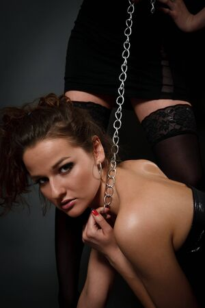 Young beautiful woman playing in slave photo
