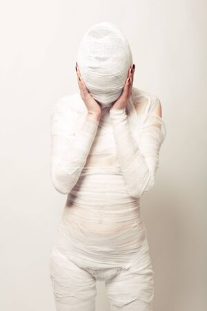 Girl dressed as a bandaged mummy photo