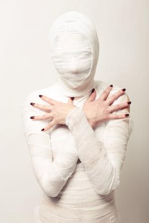 Girl dressed as a bandaged mummy photo