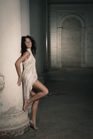 Beautiful sexy woman posing in a castle interior