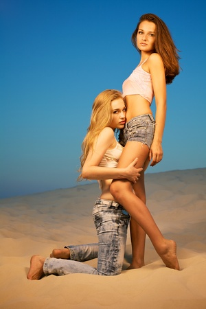 Two beautiful girls in the desert Stock Photo - 9420029