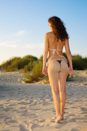 Back and ass of beautiful woman on the beach photo
