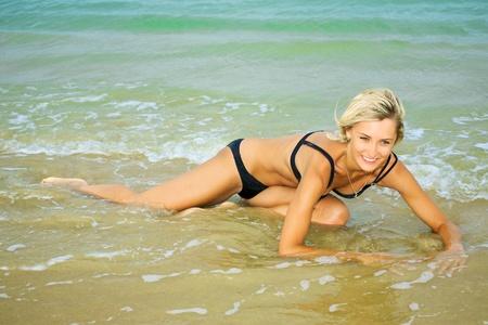 Portrait of a beautiful woman in bikini photo