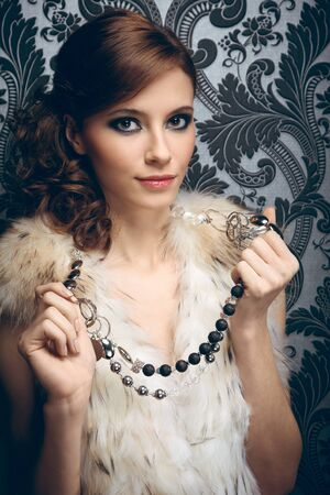 Portrait of pretty young woman with beads photo