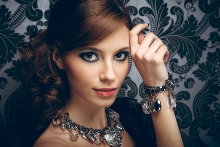 Portrait of pretty young woman with beads and bangle Stock Photo - 12384956
