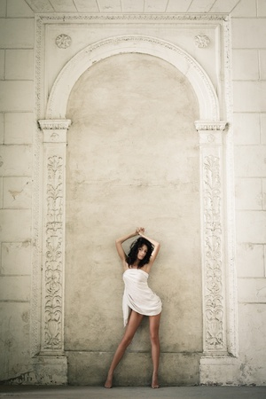 roman pillar: Beautiful sexy woman posing in a castle interior