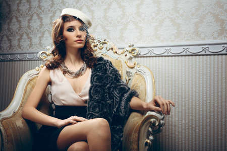 bonnet up: Portrait of pretty young woman in retro style Stock Photo