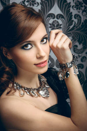 bangle: Portrait of pretty young woman with beads and bangle