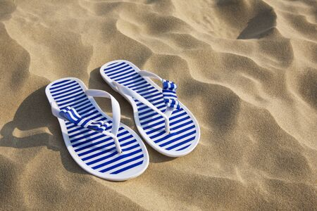 flip flop: Flip-flops on sand beach with copy space Stock Photo